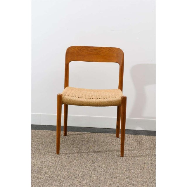 A Lovely surviving set of eight ( 8 ) model # 75 teak dining chairs by Niels Moller for J L Mollers Mobelfabrik, circa...