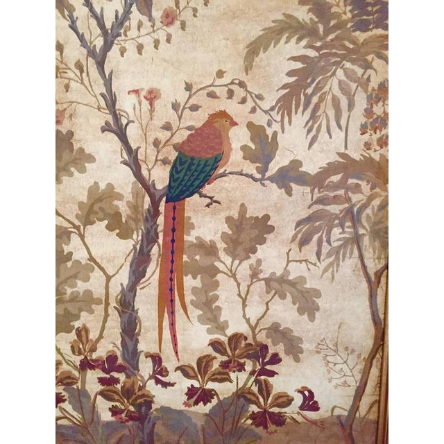 Large gouache painting on faux-leather depicting a parrot in a stylized landscape; gilt frame.