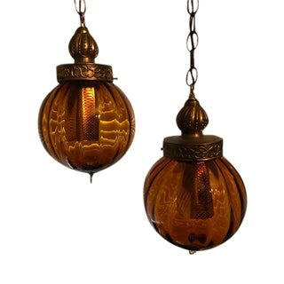 1960s Swag Hanging Amber Blown Glass Globe Pendant Lights - a Pair For Sale