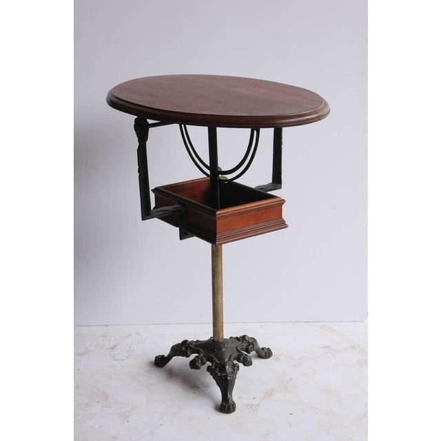 Rare antique tilt top table with adjustable height.
