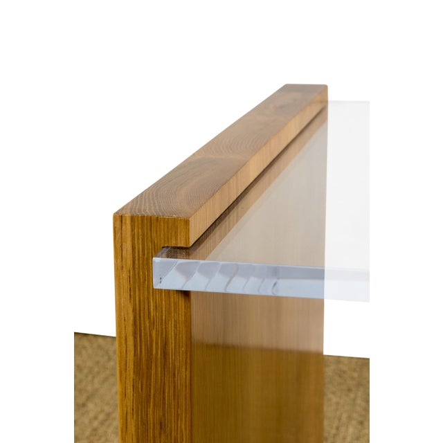 Oak base with lucite table top. Can be made in custom sizing.