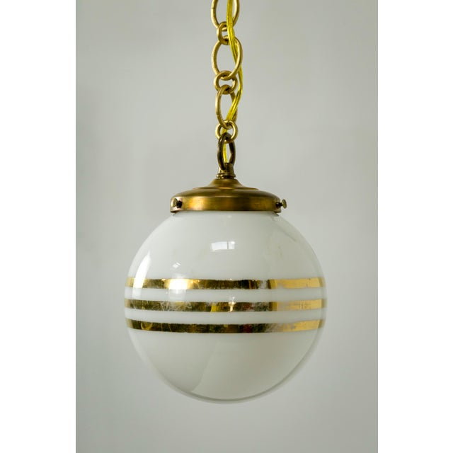 Contemporary 14-Karat Gold Striped Round White Glass Pendants - a Pair For Sale - Image 3 of 9