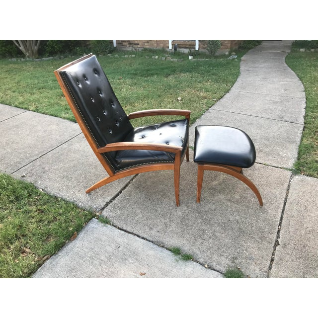 Extremely rare solid walnut chair and ottoman designed by Barney Flagg for Drexel. Retains it's original black faux...