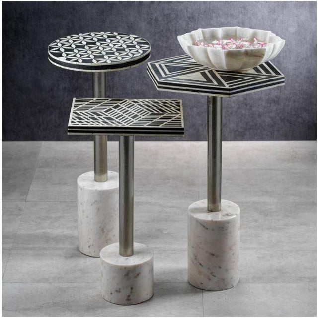 A clean and modern drinks table made from inlaid pieces of bone, set atop a sturdy marble base. The perfect spot of coffee...
