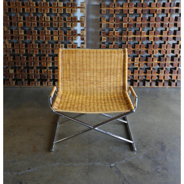 """This is a vintage cane & chrome plated steel """" sled """" chair. The piece was constructed in the USA circa 1966."""