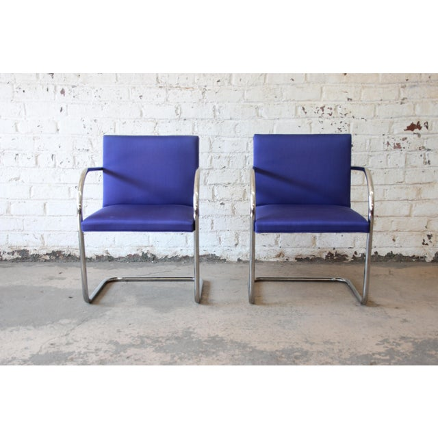 An excellent pair of Brno tubular chairs in indigo blue wool upholstery. Designed by Ludwig Mies van der Rohe in 1930 for...