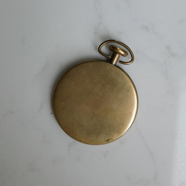 Brass pocket watch paperweight by Carl Auböck. Unsigned.
