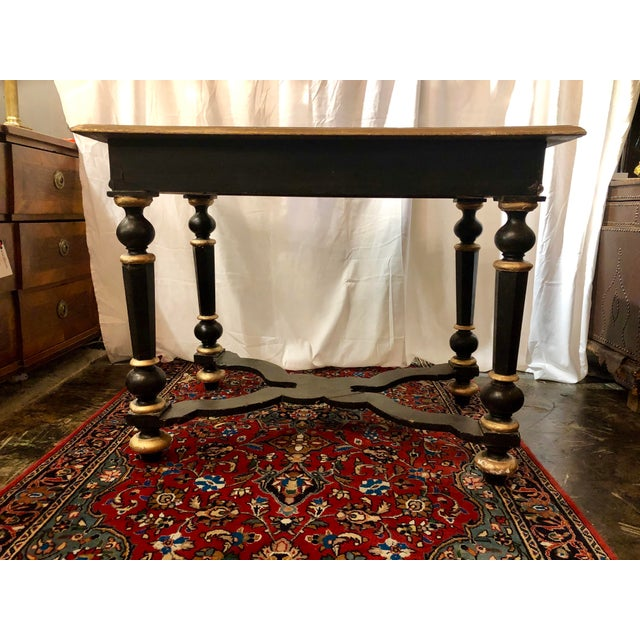 Done up in the Louis XIII style in black lacquer with gilded accents this table certainly makes a statement! I love the...