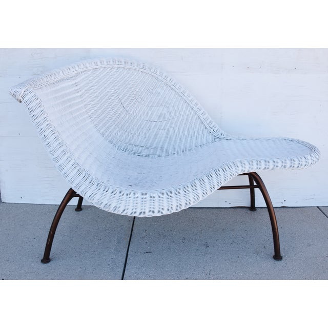 Large vintage modernistic asymmetric woven wicker chaise lounge with sturdy metal frame. Can be used indoors or outdoors....