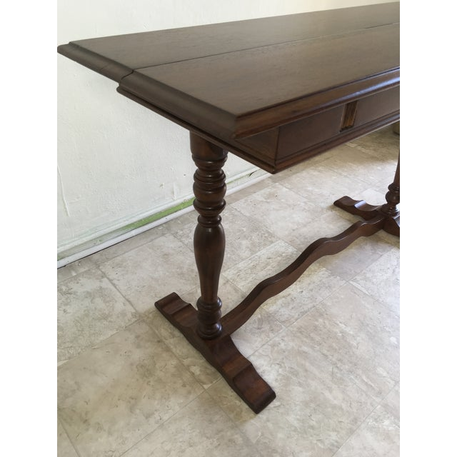 Rare and unusual expandable antique desk or dining table by B. Walter Company of Wabash Indiana. Fantastic sliding leaf...