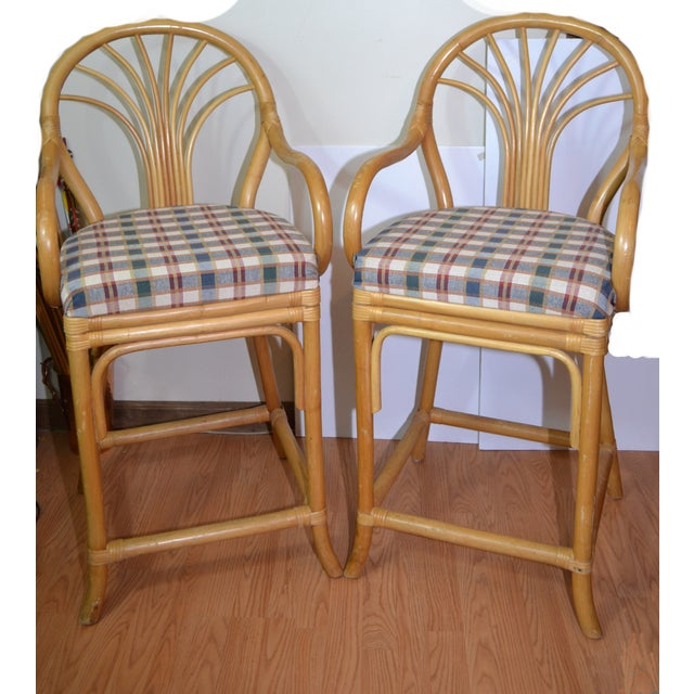 This is a vintage set of 2 rattan bar stools. These are super comfortable with well padded seats and arm rests. These...