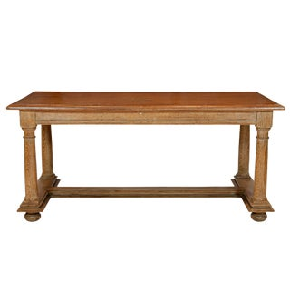 A Cerused Oak Coffee Table Featuring Shaped Column Supports on Bun Feet. Attributed to Jean Charles Moreux For Sale