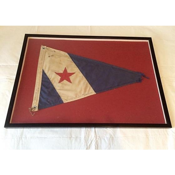 "Framed Cohasset MA Yacht Club Burgee. Flag marked ""Ships Store Inc"". Fair, wear consistent with age and use, frayed point,..."