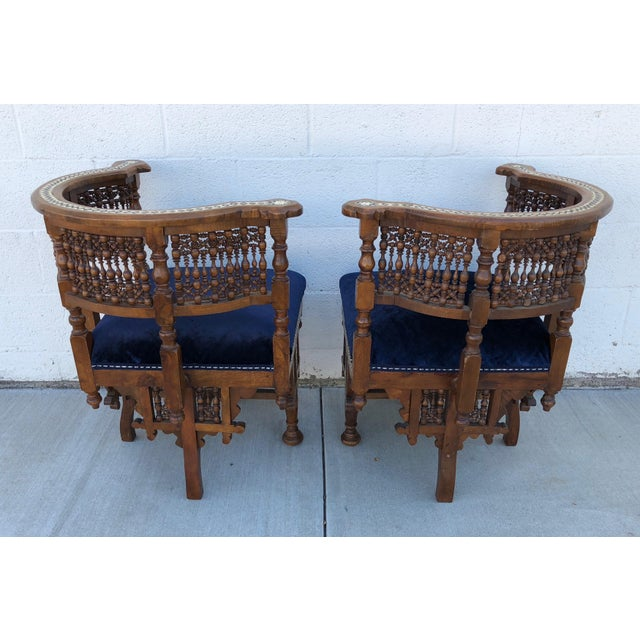A wonderful pair of Moroccan corner chairs, so intricate: a marvelous example of the fine workmanship of this region of...