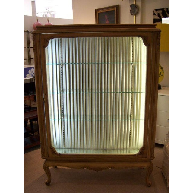 This turn of the century vitrine out of a French perfume shop is double sided with large hand made beveled glass panes on...