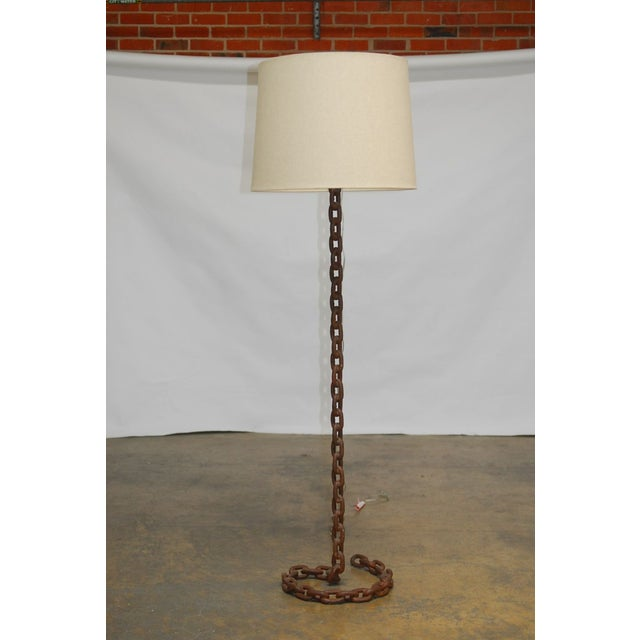 Unique floor lamp made of thick nautical chain links with a rusty finish. Inspired by a Marrakech snake charmer, this...