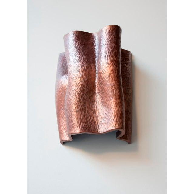 Ji Guan Sconce Antique Copper Hand Repoussé Limited Edition Repoussé is the traditional art of hand-hammering decorative...