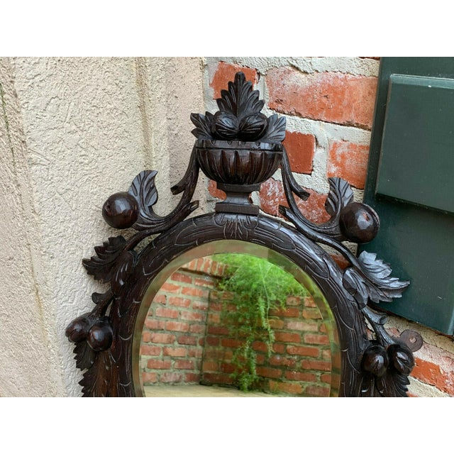 Late 19th Century 19th Century Antique English Black Forest Style Carved Dark Oak Oval Wall Mirror For Sale - Image 5 of 13