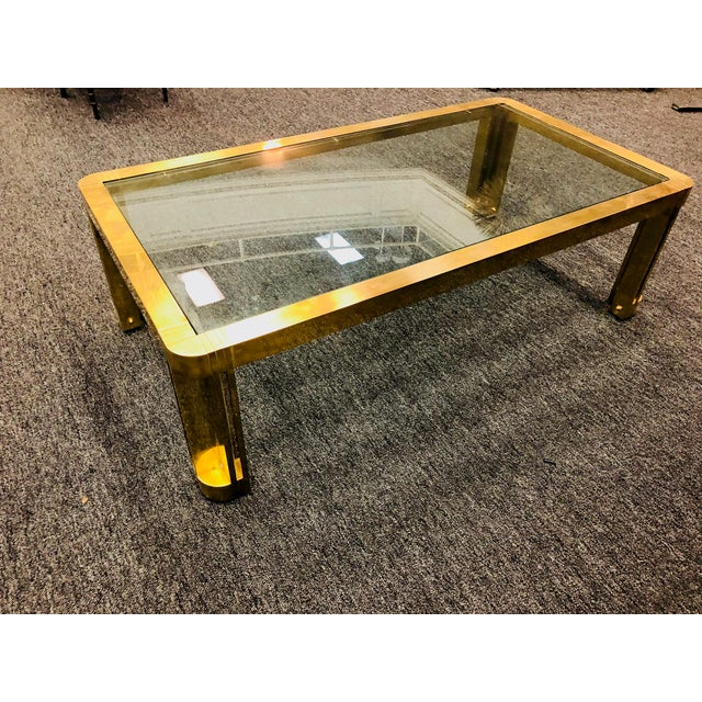 """Amazing Italian brass coffee table with great design, 1970's. Measures 28"""" by 52"""", 16"""" high. In good vintage condition...."""