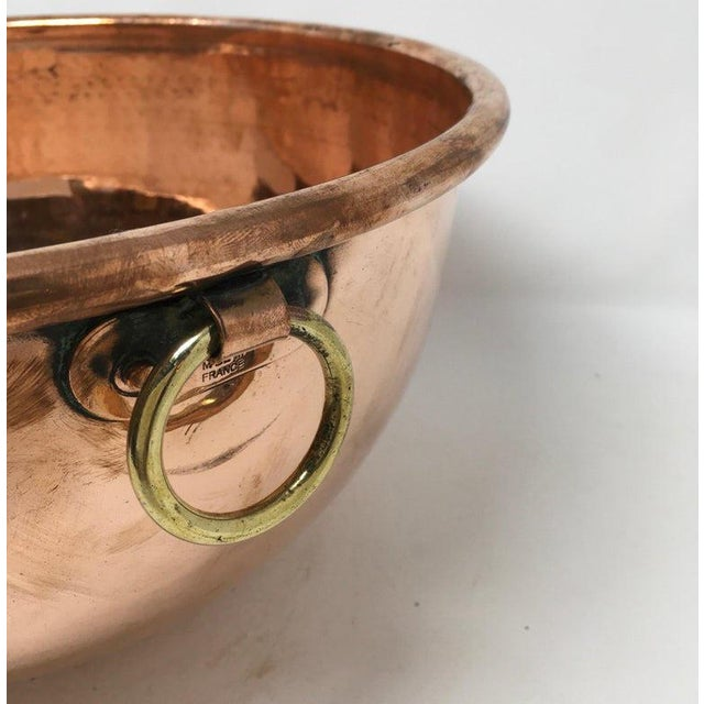 Large copper mixing bowl with brass loop handle. Found in England. This beautiful copper bowl will make a nice addition to...