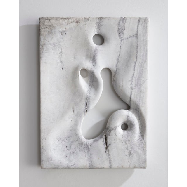 Unique wall-mounted illuminated sculpture in hand-carved white travertine. Designed and made by Rogan Gregory, USA, 2016.