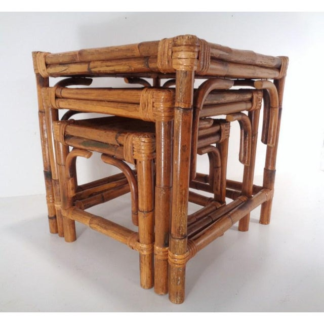 Lovely, versatile 1950's wrapped bamboo nesting tables with tightly woven herringbone top surfaces. Cubed tables measure...