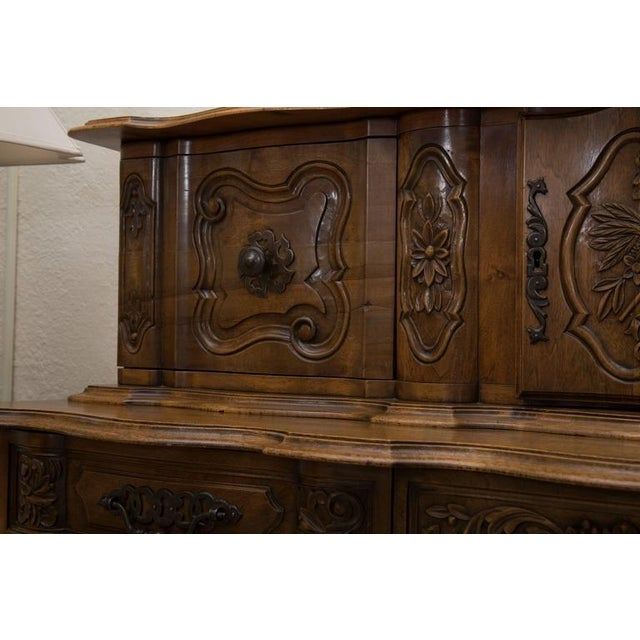 This beautiful bench-made intricately carved over-all walnut French, Louis XV style buffet has the unique feature of a...