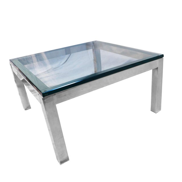 "A stylish, bold, low square, polished chrome, and glass coffee table, Milo Baughman Style. Features 2"" thick chrome frame,..."
