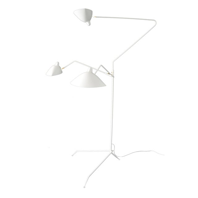 This is the most versatile lamp of the Mouille collection. Each 'chapeau' shade can be oriented differently. Sculptural in...