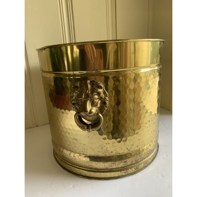 Classic hammered gold toned brass lion head vessels. Loop side handles. Set of two. Couple of small dings. Vintage classic...