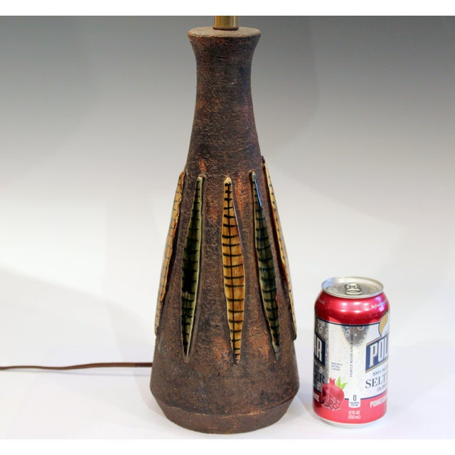 """Bitossi lamp with applied strips on an unglazed ground, circa 1960's. 26 1/2"""" high, 13 1/2"""" to top of pottery, 5 1/2""""..."""