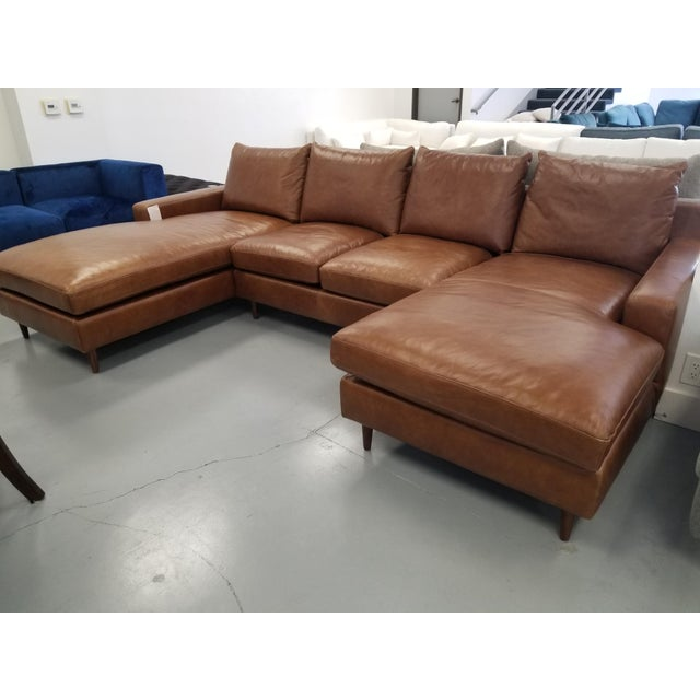 This is a beautiful large sectional sofa upholstered in top grain brown leather. The special thing about this sectional is...