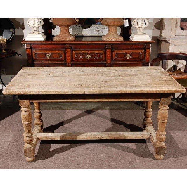 Late 19th century oak desk or writing table on ring-turned legs joined with a stretcher and raised on ball feet. Can also...
