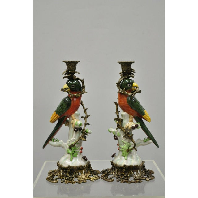 Pair of Porcelain and Bronze French Style Green & Yellow Parrot Candlestick Candle Holders. Item features ornate brass...