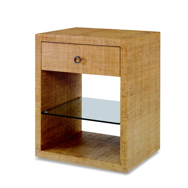 An elegant nightstand from the Century Furniture Purveyor Collection. Crafted of Mahogany Solids with Raffia. A single...