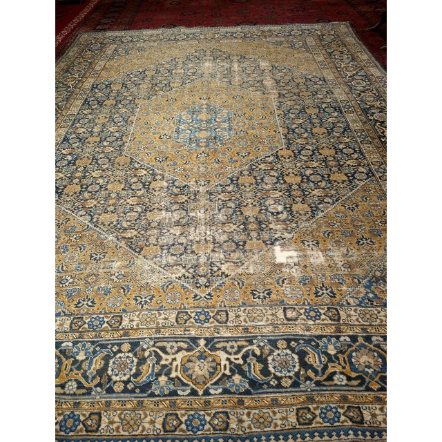 A Persian Tabriz rug from the early 1900s. Beautiful all over Herati pattern with muted colors. The Large geometric design...