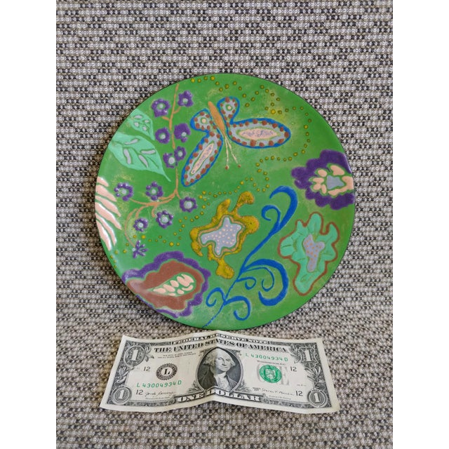 """Beautiful vintage hand enameled dish with butterfly and abstract garden forms. Copper bowl is 7 3/4"""" in diameter. Very..."""