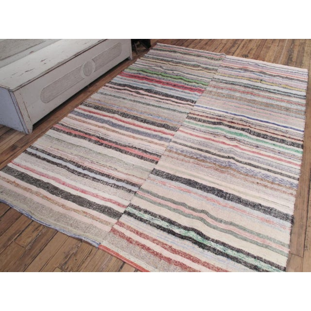 A large cotton rag kilim with a lovely range of colors. Very well made, sturdy and clean.
