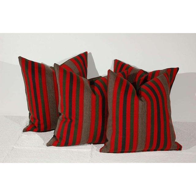 These wonderful Indian blanket pillows are all wool with a dark green wool blanket backing. The striped blanket is from...