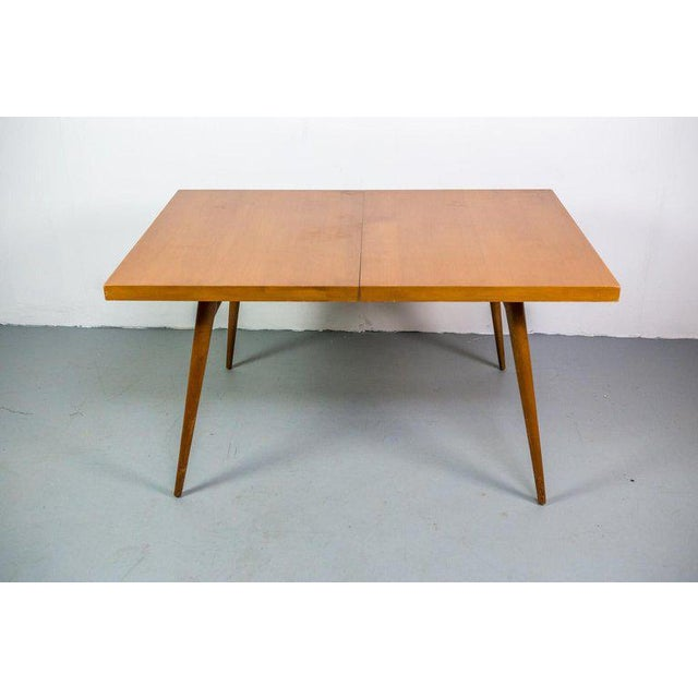 "Restored Paul McCobb ""Planner Group"" drop leaf dining table with for Winchendon Modern with two additional leaves. At its..."