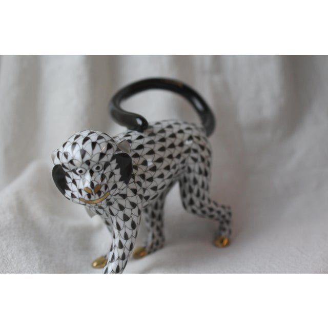 Exquisite Herend Fishnet Monkey porcelain figurine in black and white. Handmade and hand painted in Hungary with 24k gold...