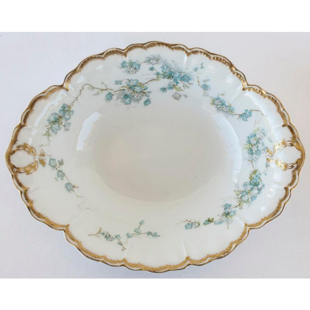Haviland Limoges serving dish or open vegetable bowl, made in France. Small graceful French blue flowers surround the...