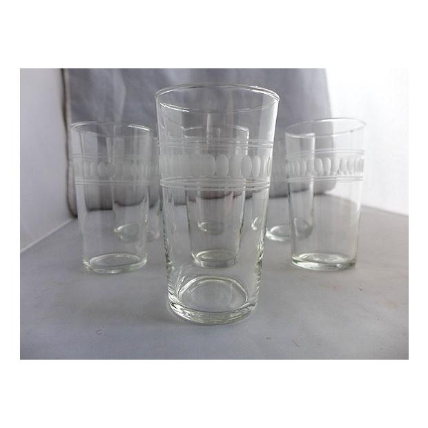 """Set of seven mid-century clear etched bar glasses. Maker's mark reads: """"L"""", for Libbey. Circa 1950s."""
