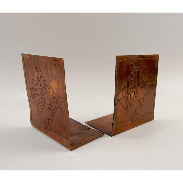 Circa 1920's artist made copper bookends. Etched with the artdeco design of a scottie dog. Unsigned. Overall patina,...