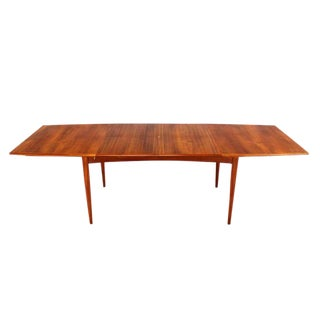 Danish Modern Teak Boat Shape Dining Table with Two Pop-Up Leafs Extension Board For Sale