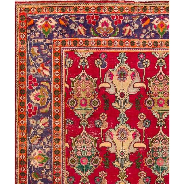 Vintage hand-knotted Persian Tabriz rug with a medallion motif. This piece has magnificent detailing and great colors. It...