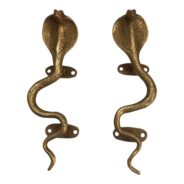 Add a touch of Hollywood Regency to your doors or cabinets with this fabulous pair of gold brass cobra handles. Beautiful...