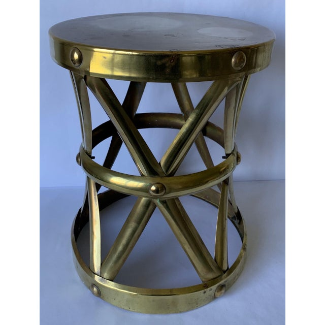 1970s brass tabourert X-frame stool. Original brass finish with overall unpolished patina.