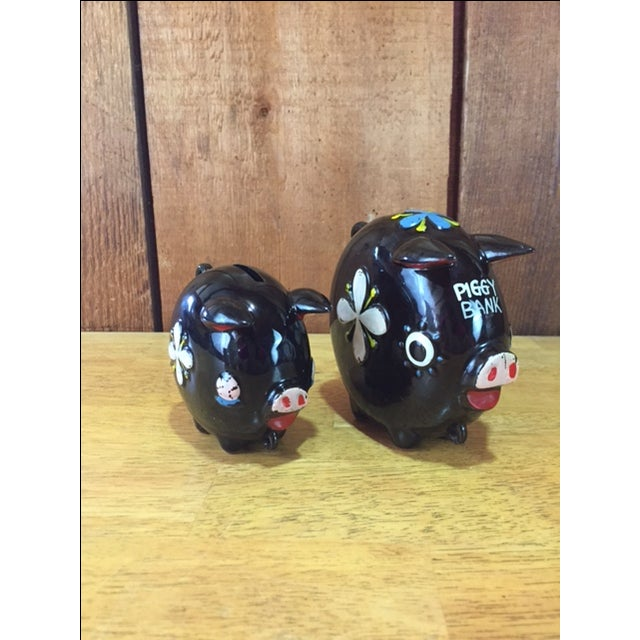 """Hand-painted Tilso Piggy Banks 2pc Set. Vintage brown piggy banks with painted flowers marked """"Tilso Made in Japan"""". This..."""