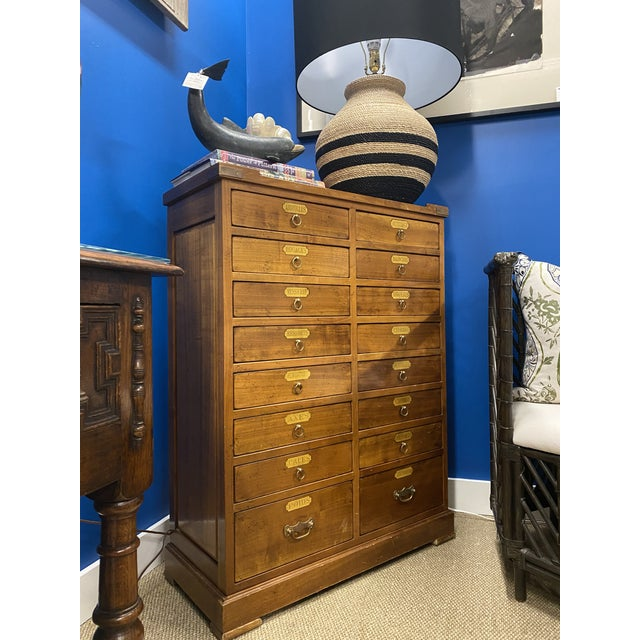 Beautiful French Apothecary custom made cabinet, made from oak and features 16 drawers, originals brass handles.